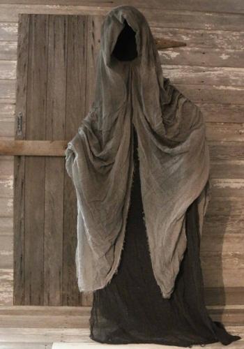 standing faceless reaper